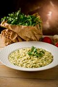 risotto with herbs - stock photo