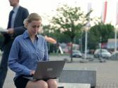 Businesswoman working on laptop computer in the city NTSC Stock Footage