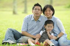 Asian family having a picnic during outdoor ,focus on baby Stock Photos