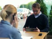 Businessman couple with tablet computer and cellphone in the city NTSC Stock Footage