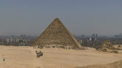 Pyramid and camels, in Egypt Stock Footage