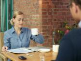 Business colleagues talking and drinking coffee in cafe NTSC Stock Footage