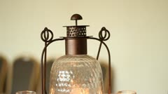 Tilt Down Old Fashioned Lantern and Candles on Table Stock Footage