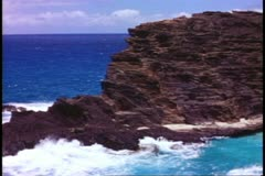 Stock Video Footage of Hawaii, Island of Oahu cliffs and sea, rugged and jagged, medium shot