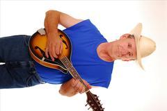 Senior playing mandolin - stock photo