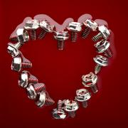 heart from screws in red - stock photo