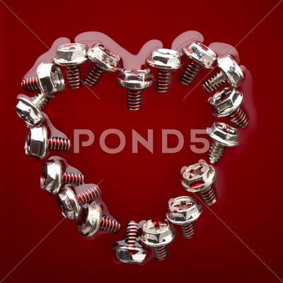 Stock photo of heart from screws in red