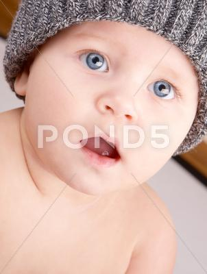 Stock photo of child in a knitted hat.