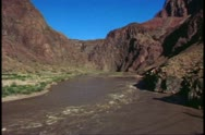 The Grand Canyon, view from the bottom, wide view of The Colorado River Stock Footage