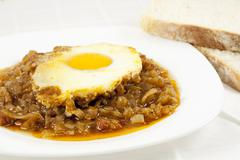 stew with baked onion, egg and meat - stock photo