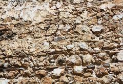 antique stone wall - stock photo