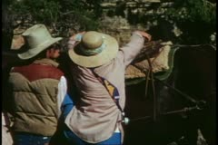 The Grand Canyon mule ride, medium shot, mounting the mule, humorous - stock footage