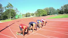 100m sprinters starting slow motion Stock Footage