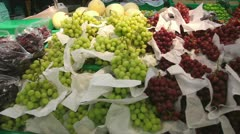 Grapes and other fruits in a fruit stall Stock Footage