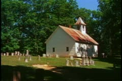 Great Smoky Mountains National Park, white clapboard church and graveyard - stock footage