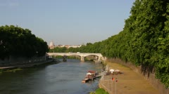 Rome, Lungotevere: river Tevere, bridge and St. Peter - stock footage
