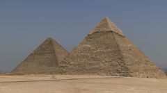 Car driving in front of pyramids Stock Footage
