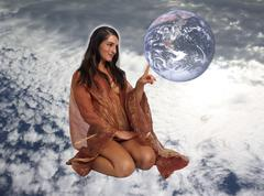 Beautiful seminude woman touching the earth Stock Photos