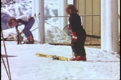 Yosemite National Park, California, children learning to ski, girl drop ski Stock Footage