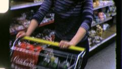 CONSUMER SUPERMARKET Woman Shopping Cart 1970 Vintage Film Retro Home Movie 3739 - stock footage
