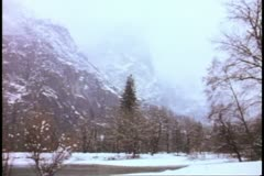 Yosemite National Park, California, beautiful, wintry scene, snow falling Stock Footage