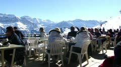 Skiers on restaurant deck  12558.MP4 Stock Footage