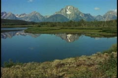 Grand Tetons National Park, Moraine Mountain, wide shot, mirrored in Moraine Stock Footage