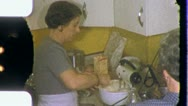 Stock Video Footage of Woman Cooking MAKING A CAKE Kitchen 1950s (Vintage Old Film Home Movie) 3783