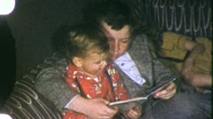 BIG BROTHER READING to Little Boy Storybook 1940s (Vintage Film Home Movie) 3786 - stock footage