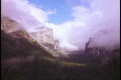 Yosemite National Park, California, misty, El Capitan and waterfall and Half Stock Footage