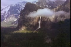 Yosemite National Park, California, misty, view El Capitan and waterfall, clouds Stock Footage
