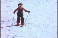 Yosemite National Park, California, children learning to ski, boy with two poles Stock Footage