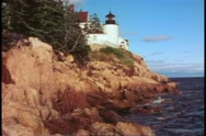 Stock Video Footage of Maine lighthouse and sea and cliff, Acadia National Park