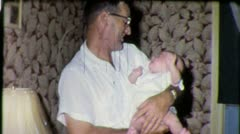 Happy GRAND DAD Holds New Baby Daughter 1950s (Vintage Film Home Movie) 3810 Stock Footage