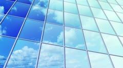 Clouds reflected in windows of skyscraper loop Stock Footage