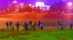 Crowd at public transport stop urban night timelapse Stock Footage
