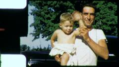 Fathers Hold Babies Son Wave Hello Proud 1950s Vintage Film Home Movie 3842 Stock Footage