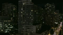 Pan r to l across night skyline Vancouver Yaletown Stock Footage