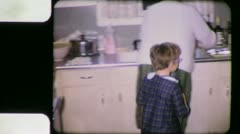 HELPING GRANDMA KIDS in the Kitchen 1960s (Vintage Old Film Home Movie) 3870 - stock footage