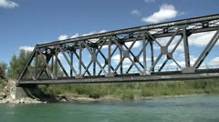 Railroad, freight train crosses bridge over river, front end AC4400 locomotives Stock Footage