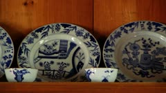 Pottery Dishes on Shelve Stock Footage