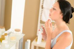 young woman bathroom clean face make-up removal - stock photo