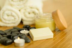 Spa body care products and towels close-up Stock Photos