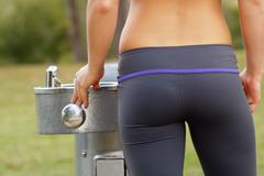 beautiful female athlete at a water fountain (2) - stock photo