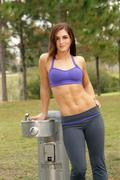 beautiful female athlete at a water fountain (4) - stock photo