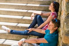 young happy couple flirting on the stairs - stock photo