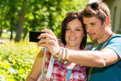 Stock Photo of young couple in love take picture themselves