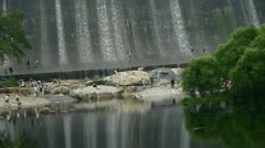 People are playing under dam,Waterfall texture. Stock Footage