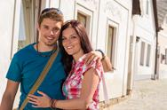 Happy love couple embracing smiling in city Stock Photos