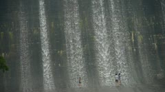 People are playing under dam,Waterfall texture,rainy season. Stock Footage